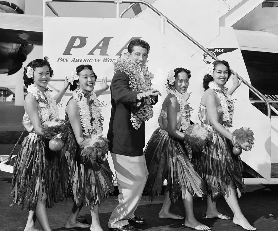 . Billy Martin, New York Yankee second baseman and hero of the World Series, proved to be a versatile chap off the baseball diamond, too, on his arrival in Honolulu, Oct. 15, 1953 with the Ed Lopat All-Stars. Assisting Billy in the Hula dance are, left to right, Beatrice Kalaiwaa, Bernie Ah Nee, Nalei Ah Nee and Mae Bimes. (AP Photo)