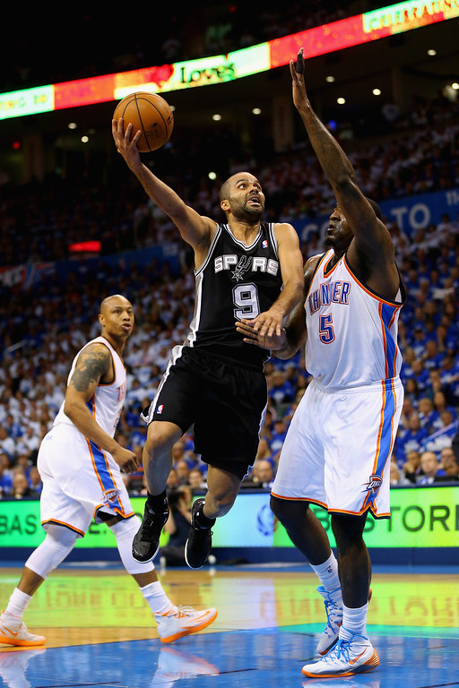 . OKLAHOMA CITY, OK - MAY 27: Tony Parker #9 of the San Antonio Spurs drives to the basket against Kendrick Perkins #5 of the Oklahoma City Thunder in the first half during Game Four of the Western Conference Finals of the 2014 NBA Playoffs at Chesapeake Energy Arena on May 27, 2014 in Oklahoma City, Oklahoma. (Photo by Ronald Martinez/Getty Images)