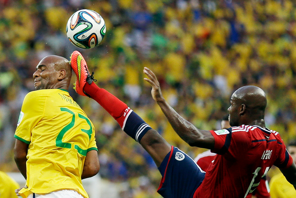 . Colombia\'s Victor Ibarbo clears the ball next to Brazil\'s Maicon\'s head during the World Cup quarterfinal soccer match between Brazil and Colombia at the Arena Castelao in Fortaleza, Brazil, Friday, July 4, 2014. (AP Photo/Natacha Pisarenko)
