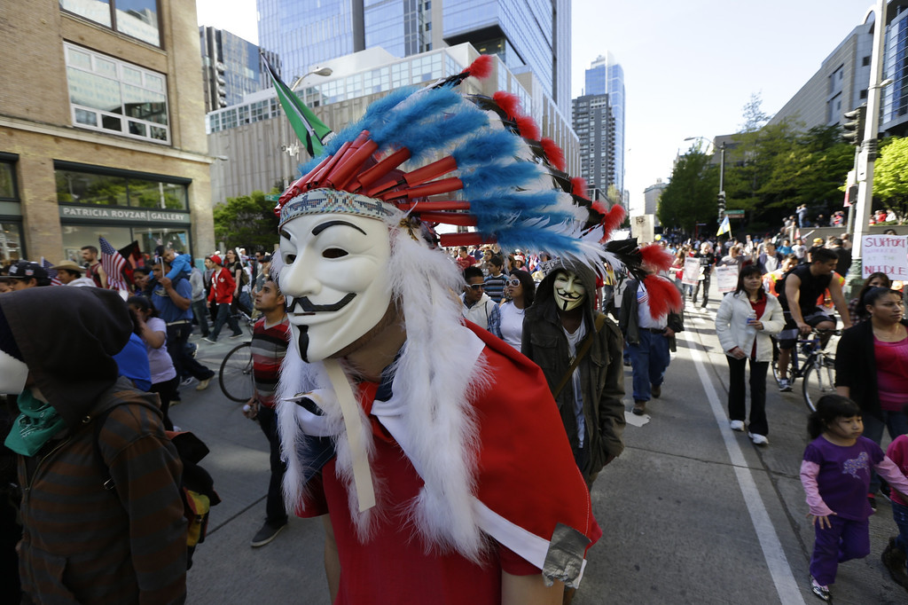 . Protesters take part in a May Day immigration rights march, Wednesday, May 1, 2013 in downtown Seattle. Demonstrators demanded an overhaul of immigration laws Wednesday in an annual, nationwide ritual that carried a special sense of urgency as Congress considers sweeping legislation that would bring many of the estimated 11 million people living in the U.S. illegally out of the shadows. (AP Photo/Ted S. Warren)