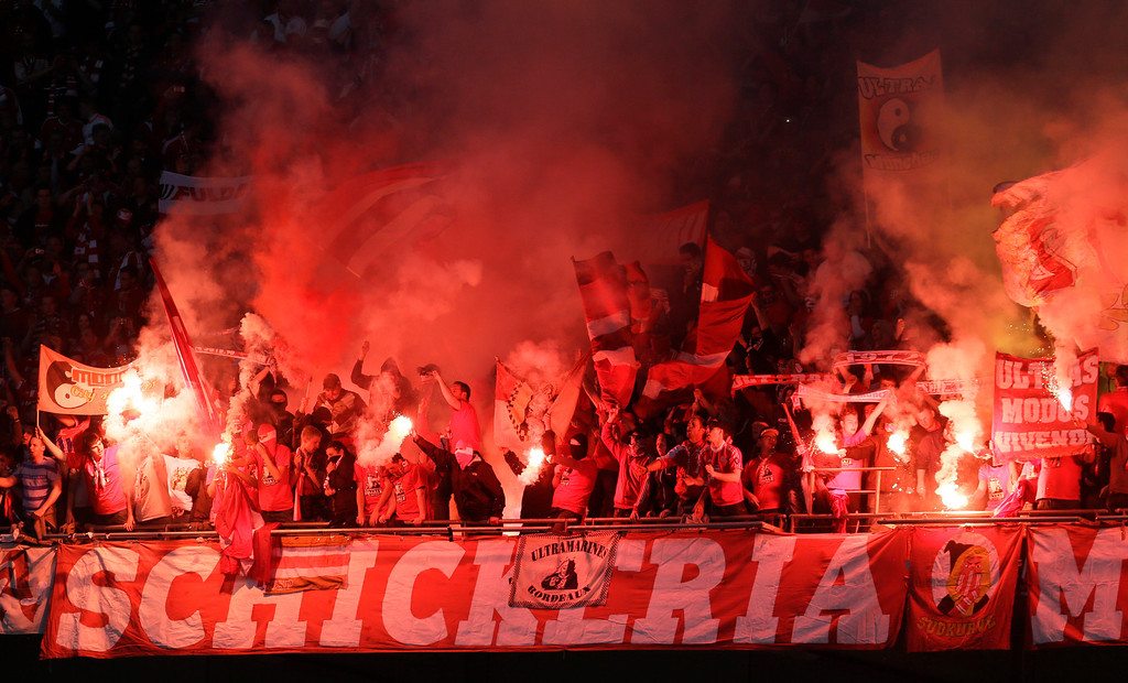 . Bayern fans light flares during the Champions League Final soccer match between  Borussia Dortmund and Bayern Munich at Wembley Stadium in London, Saturday May 25, 2013. (AP Photo/Alastair Grant)