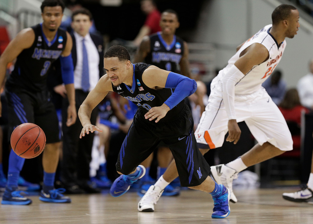 . Memphis guard Michael Dixon Jr. (11) chases a loose ball against Virginia during the second half of an NCAA college basketball third-round tournament game, Sunday, March 23, 2014, in Raleigh, N.C. (AP Photo/Chuck Burton)