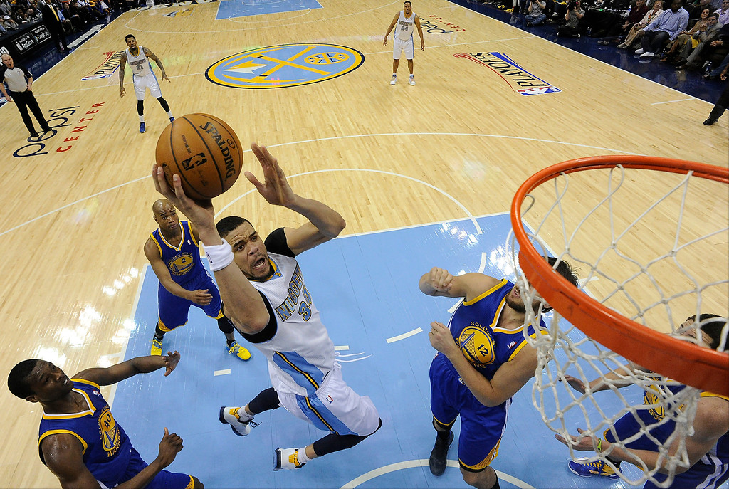 . Denver Nuggets center JaVale McGee (34) goes up for a shot in the second quarter. The Denver Nuggets took on the Golden State Warriors in Game 5 of the Western Conference First Round Series at the Pepsi Center in Denver, Colo. on April 30, 2013. (Photo by John Leyba/The Denver Post)