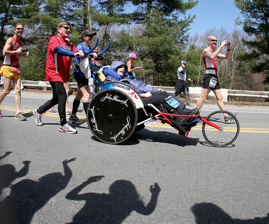 . The girls of Wellesley College cheer as father and son Dick Hoyt and Rick Hoyt, from Holland, Mass., compete in the 118th Boston Marathon, Monday, April 21, 2014 in Wellesley, Mass. (AP Photo/Mary Schwalm)