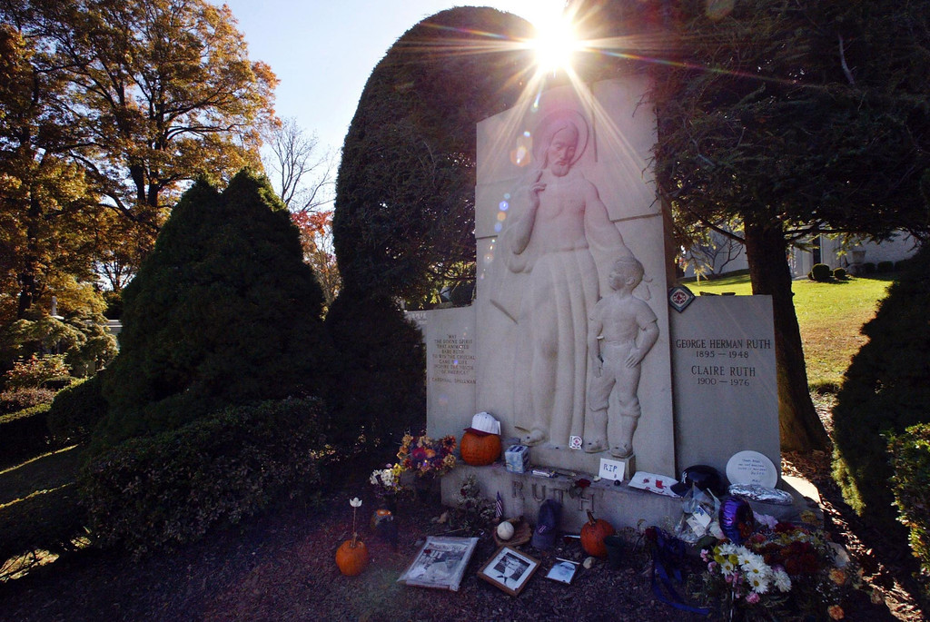 ". The grave of George Herman \'Babe\'\' Ruth is decorated with items left by New York Yankees and Boston Red Sox fans, Thursday, Oct. 28, 2004 in Hawthorne. The ""Curse of the Bambino\"" has followed Boston through four World Series defeats, each one in seven games. The end of the drought came Wednesday, Oct. 27, when Boston completed a sweep of the St. Louis Cardinals to win the World Series. (AP Photo/Mary Altaffer)"