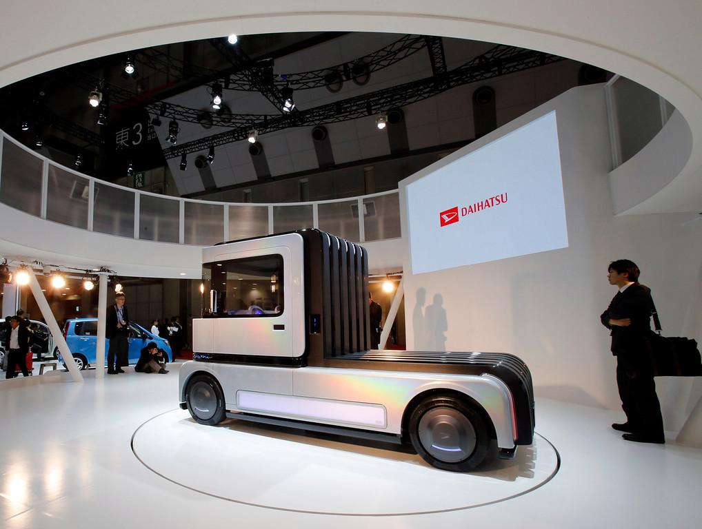 . A Daihatsu FC DECO DECK fuel-cell-powered concept car is displayed at the media preview for the Tokyo Motor Show at Tokyo Big Sight in Tokyo, Wednesday, Nov. 20, 2013.  (AP Photo/Shuji Kajiyama)