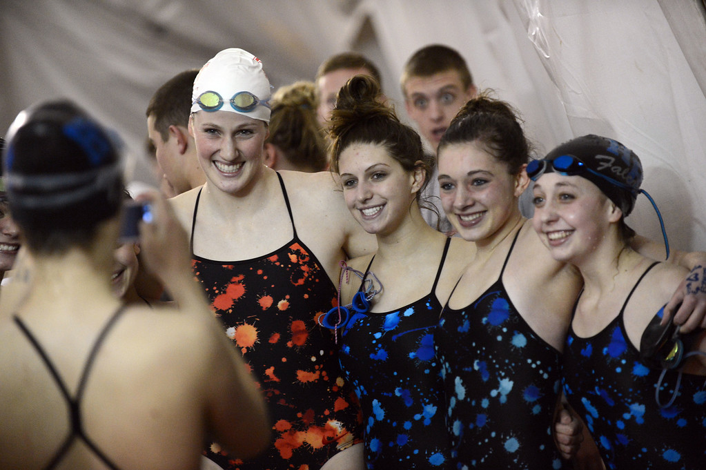 . Olympic gold medalist Missy Franklin of Regis Jesuit, second from left, takes picture with Highlands Ranch swimmers after the meet at Regis Jesuit swimming pool on Tuesday. Aurora. CO, January 8, 2013.  Hyoung Chang, The Denver Post