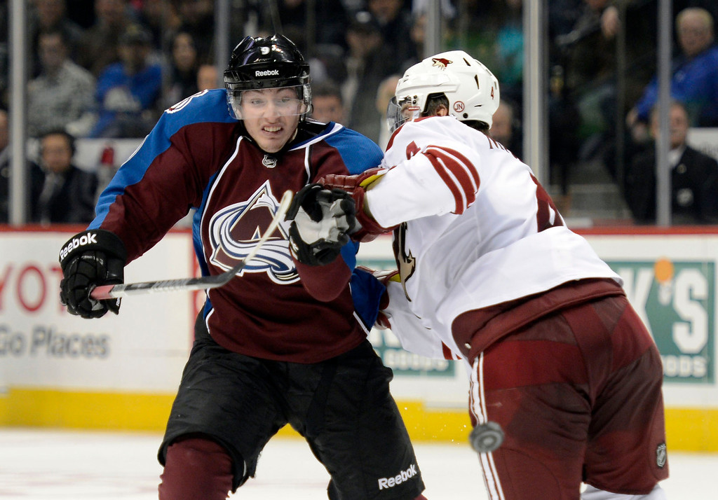 . DENVER, CO. - FEBRUARY 11: Matt Duchene (9) of the Colorado Avalanche gets a shove from Zbynek Michalek (4) of the Phoenix Coyotes as he chase after the puck during the third period February 11, 2013 at Pepsi Center. The Phoenix Coyotes defeated the Colorado Avalanche 3-2 on a Shane Doan (19) shot to beat Semyon Varlamov with 1:00 min left in overtime. (Photo By John Leyba/The Denver Post)