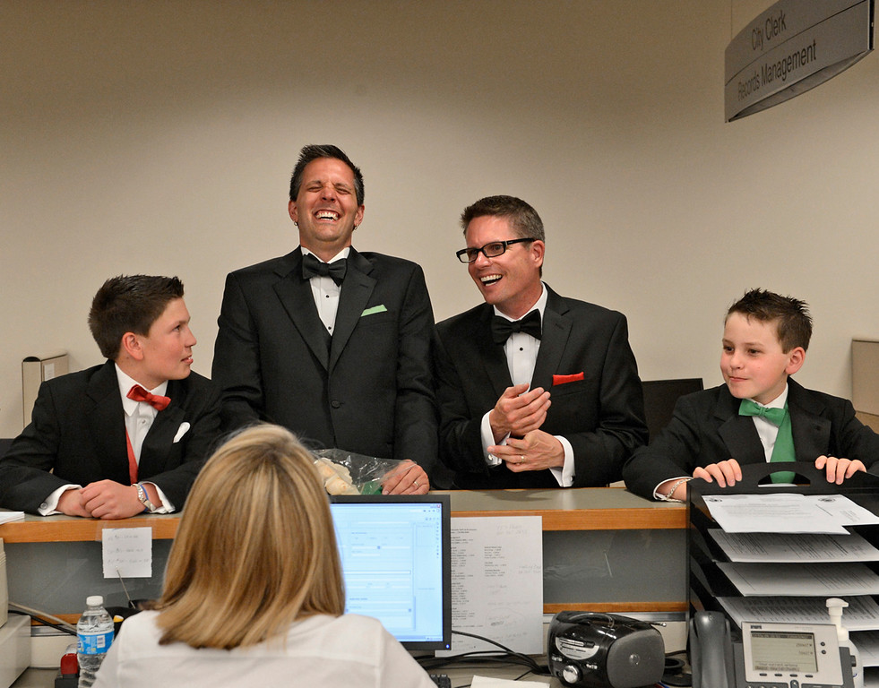 . Geoffrey Bateman, second from left, and Mark Thurn are joined by their children while applying for a civil-union license at the Clerk and Recorder\'s Office in Denver, May 1, 2013. More than 100 Colorado gay and lesbian couples put an official government seal on their relationships in the early-morning hours Wednesday, after the state\'s civil-unions law took effect.