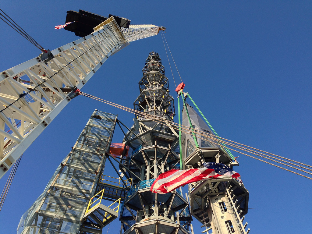 . In this May 10, 2013 file photo, the silver spire topping 1 World Trade Center is fully installed on the building\'s roof, bringing the structure to its full, symbolic height of 1,776 feet in New York. (AP Photo/Mark Lennihan)