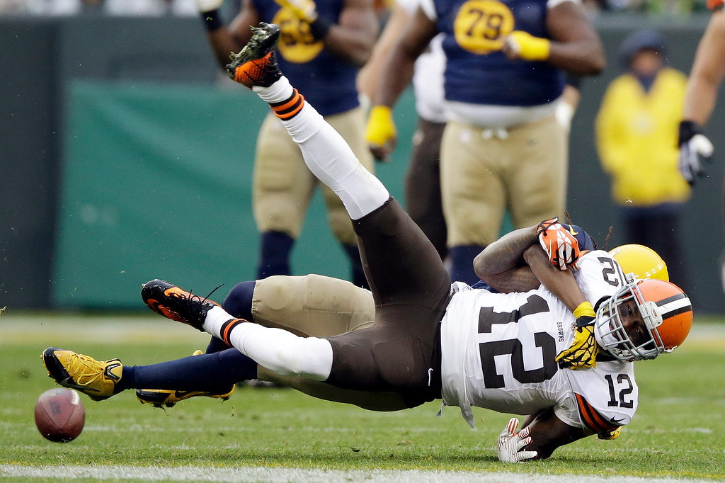 . Green Bay Packers\' Tramon Williams breaks up a pass intended for Cleveland Browns\' Josh Gordon (12) during the first half of an NFL football game Sunday, Oct. 20, 2013, in Green Bay, Wis. (AP Photo/Tom Lynn)
