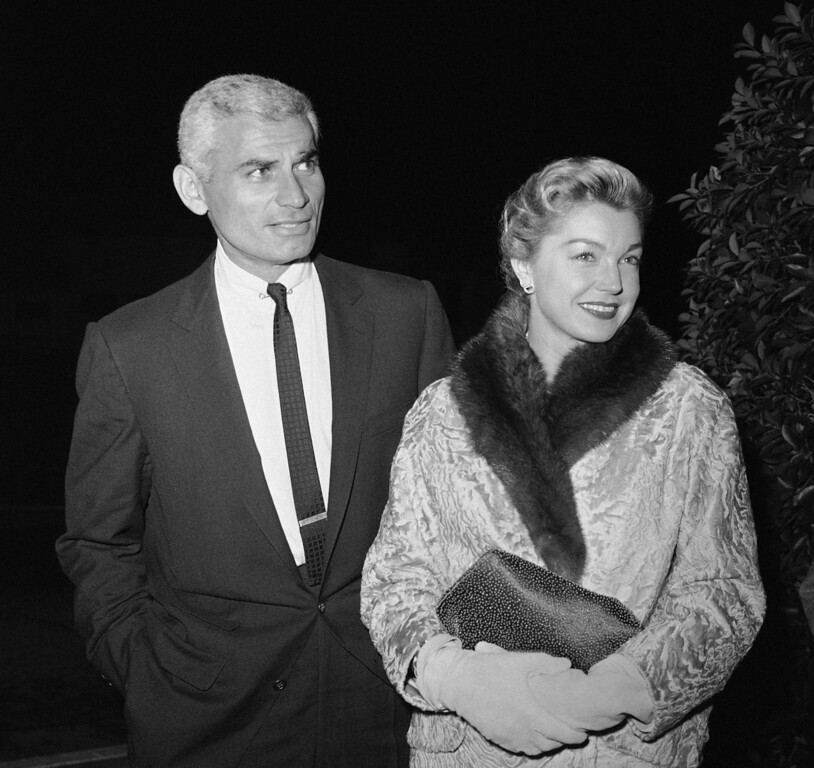 """. Jeff Chandler and Esther Williams, a steady pair in Hollywood, arrive for the invitational press preview of \""""The Perfect Furlough\"""" at the Academy Awards Theater in Hollywood, Nov. 11, 1958. (AP Photo/Harold P. Matosian)"""