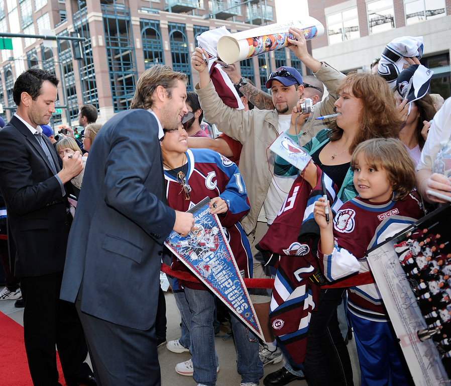. Stephane Yelle signS autographs for fans while Peter Forsberg has his photo taken with a fan outside the Chop House in Lower Downtown October 6, 2010. The Colorado Avalanche will celebrate the 15-year reunion of the 1995-96 Stanley Cup Championship Team. Members of the 1995-96 team gathered at the Denver Chop House & Brewery in lower downtown for private dinner. John Leyba, The Denver Post