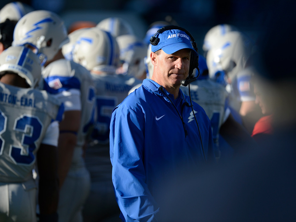 . Air Force head coach, Troy Calhoun, right, late in the game against the Colorado State Rams Saturday afternoon, November 30, 2013. Rams won 58-13. (Photo By Andy Cross/The Denver Post)