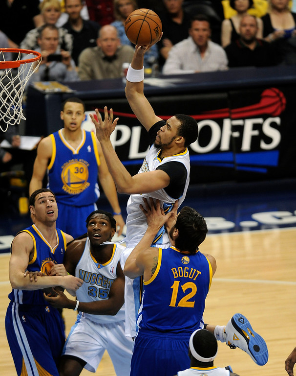 . Denver Nuggets center JaVale McGee shoots a runner in the lane over Golden State Warriors center Andrew Bogut in the first quarter. The Denver Nuggets took on the Golden State Warriors in Game 5 of the Western Conference First Round Series at the Pepsi Center in Denver, Colo. on April 30, 2013. (Photo by Steve Nehf/The Denver Post)N