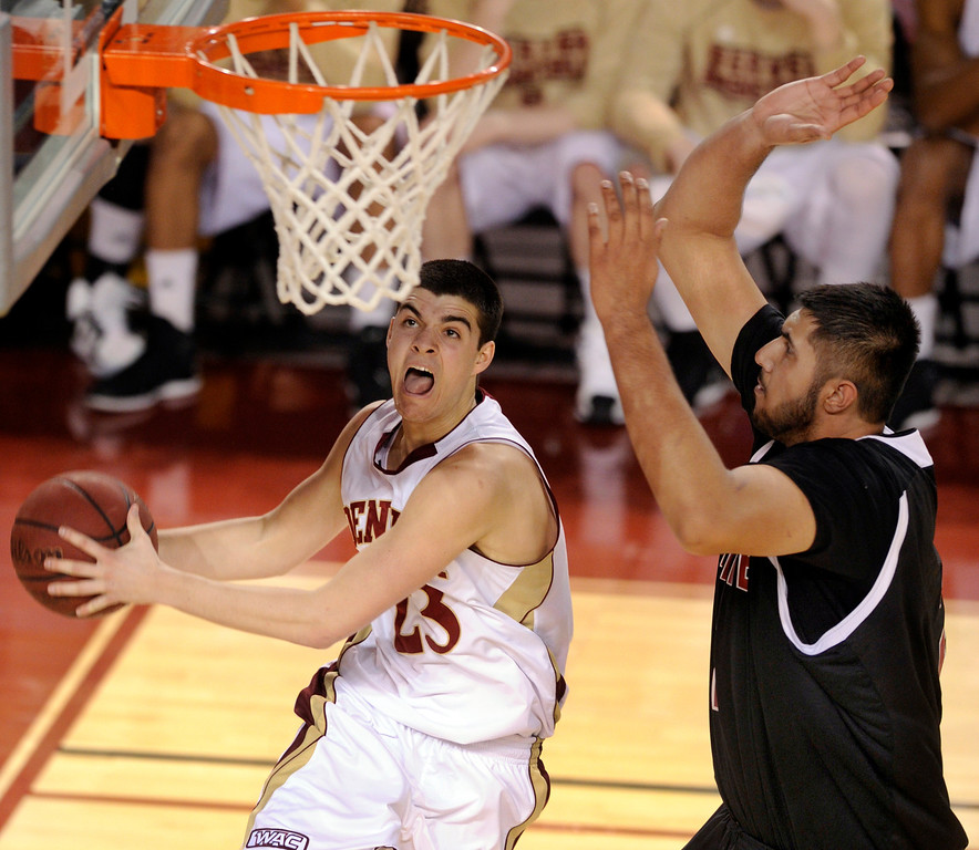 . DENVER, CO. - MARCH 2: Denver guard Brett Olson (23) drove past New Mexico center Sim Bhullar (2) in the second half. The University of Denver men\'s basketball team defeated New Mexico State 66-60 Saturday evening, March 2, 2013 at Magness Arena. (Photo By Karl Gehring/The Denver Post)