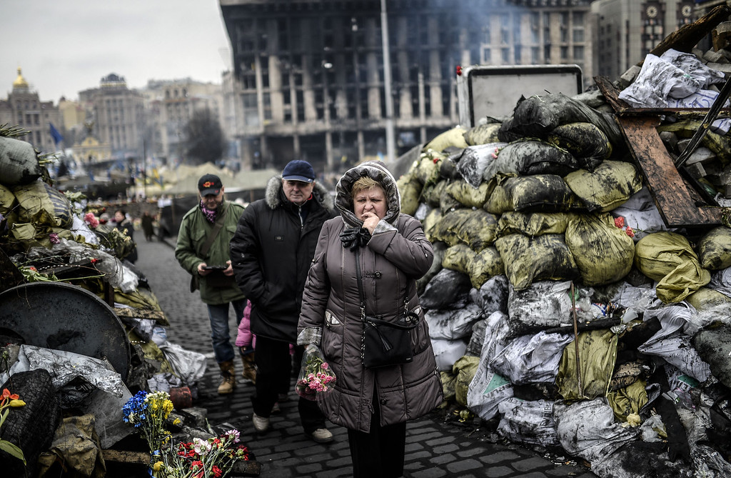 . A woman reacts as she arrives at barricades in central Kiev on February 28, 2014. Ukraine\'s parliament on Thursday approved the nomination of pro-EU Arseniy Yatsenyuk as the crisis-hit country\'s new prime minister until presidential polls are held in May. AFP PHOTO/BULENT KILIC/AFP/Getty Images