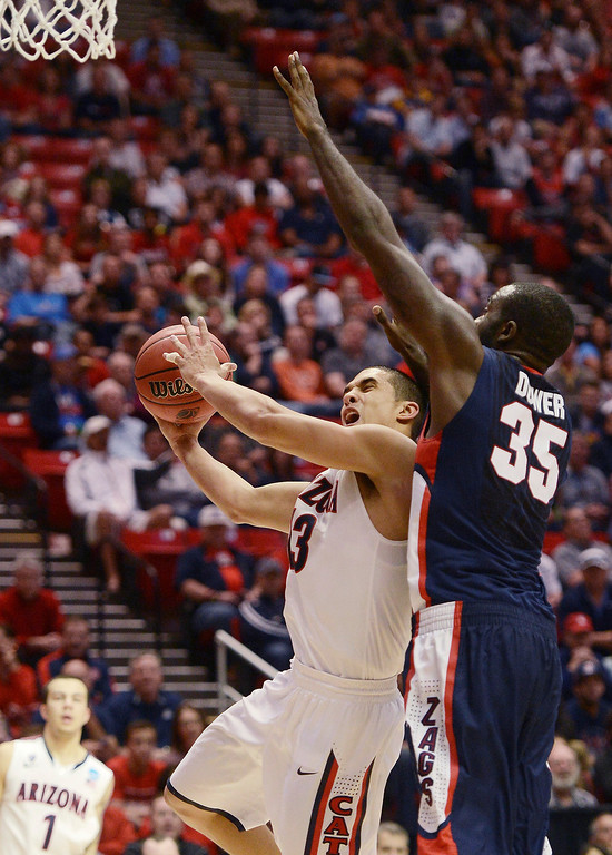 . Nick Johnson #13 of the Arizona Wildcats goes up against Sam Dower #35 of the Gonzaga Bulldogs in the second half during the third round of the 2014 NCAA Men\'s Basketball Tournament at Viejas Arena on March 23, 2014 in San Diego, California.  (Photo by Donald Miralle/Getty Images)