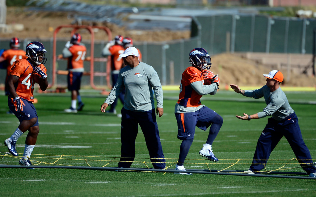 . The running backs run through drills during practice. The Denver Broncos practice at Dove Valley on Monday, Sept. 1, 2014 in preparation for their season opener against the Indianapolis Colts on Sunday night. (Kathryn Scott Osler/The Denver Post)