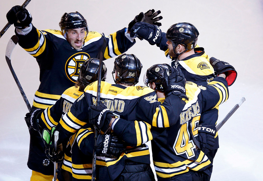 . Boston Bruins\' Brad Marchand (L) and teammates celebrate a goal against the Pittsburgh Penguins by Adam McQuaid (54) during the third period in Game 4 of their NHL Eastern Conference finals hockey playoff series in Boston, Massachusetts, June 7, 2013. REUTERS/Brian Snyder