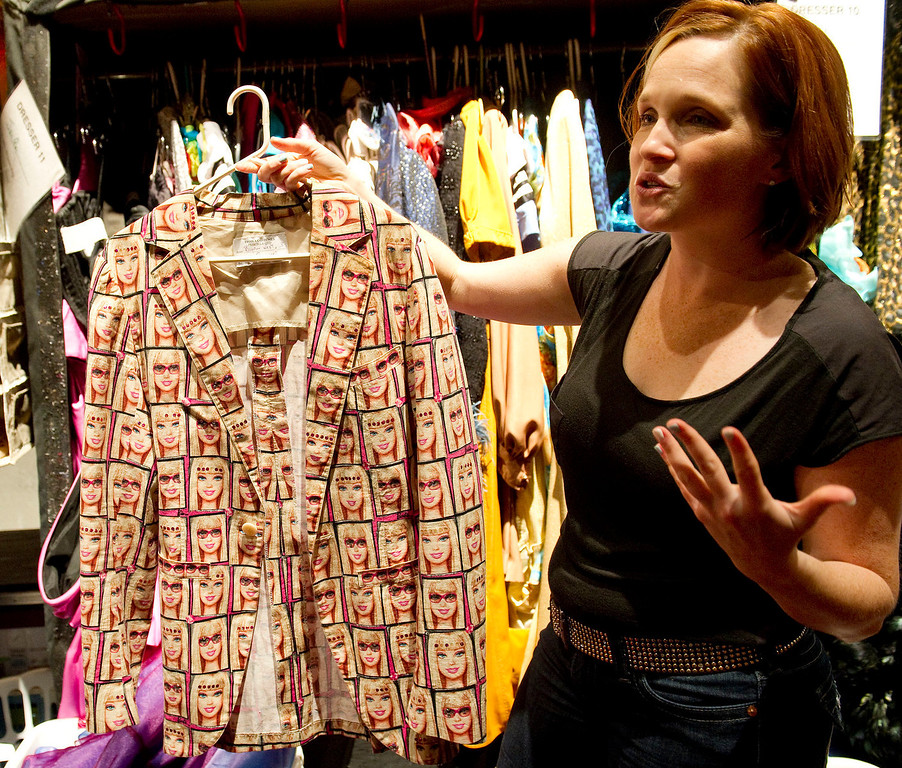 """. Wardrobe supervisor Gillian Austin holds up a Barbie jacket backstage at the Buell Theatre for the colorful production of \""""Priscilla Queen of the Desert The Musical\"""" on Thursday September 5, 2013. There are over 500 Tony Award winning costumes.   (Photo By Cyrus McCrimmon/The Denver Post )"""
