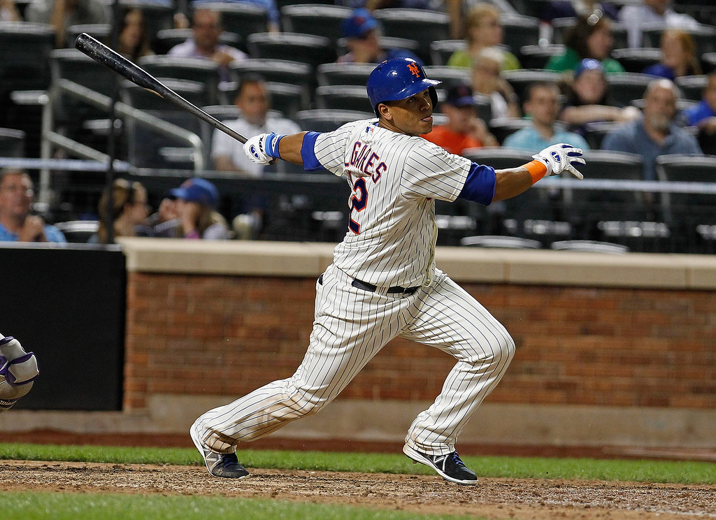 . Juan Lagares #12 of the New York Mets drives in the go ahead run with a single in the eighth inning against the Colorado Rockies at Citi Field on August 6, 2013 at Citi Field in the Flushing neighborhood of the Queens borough of New York City. Mets defeated the Rockies 3-2.  (Photo by Mike Stobe/Getty Images)