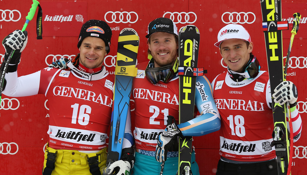 . Norway\'s Kjetil Jansrud, center, winner of an alpine ski, men\'s World Cup super-g, poses for photographers on the podium with second-placed Switzerland\'s Patrick Kueng, left, and third-placed Austria\'s Matthias Mayer, in Kviitfjell, Norway, Sunday, March 2, 2014. (AP Photo/Alessandro Trovati)