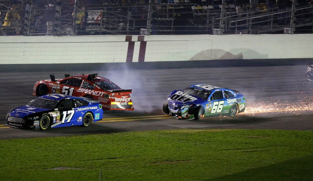 . Michael Waltrip (66), Justin Allgaier (51) and Ricky Stenhouse Jr. (17) are involved in a crash during the NASCAR Daytona 500 Sprint Cup series auto race at Daytona International Speedway in Daytona Beach, Fla., Sunday, Feb. 23, 2014. (AP Photo/John Raoux)