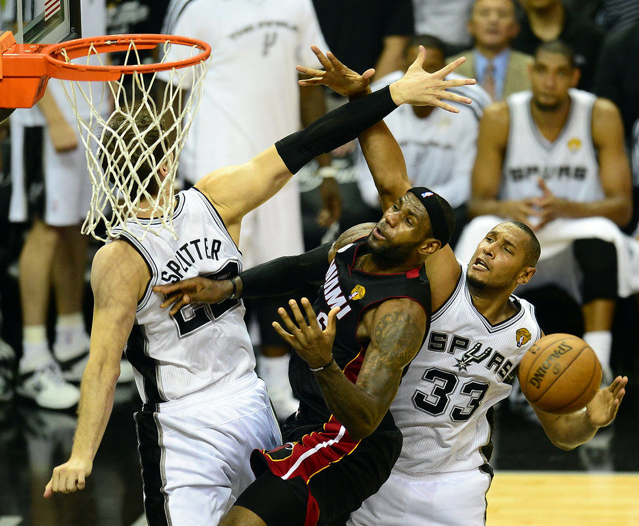 . LeBron James of the Miami Heat runs into tough defense from Tiago Splitter and Boris Diaw of the San Antonio Spurs during game 5 of the NBA finals on June 16, 2013 in San Antonio, Texas., where the Spurs defeated the Heat 114-104 and now lead the series 3-2. FREDERIC J. BROWN/AFP/Getty Images