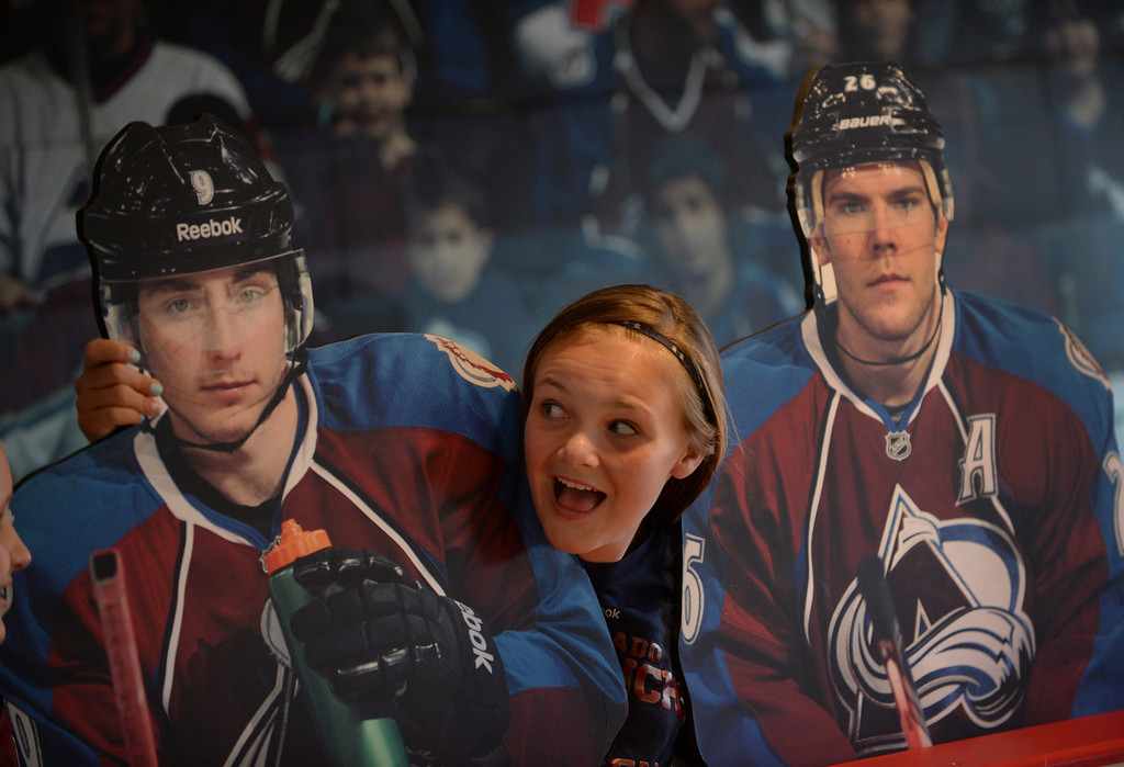 . DENVER, CO - APRIL 24: Lucy Munro, age 11, made a face as she posed between cutouts of Colorado players Matt Duchene and Paul Stastny before the game Saturday night. The Colorado Avalanche hosted the Minnesota Wild in the fifth game of a playoff series Saturday night, April 26, 2014. (Photo by Karl Gehring/The Denver Post)