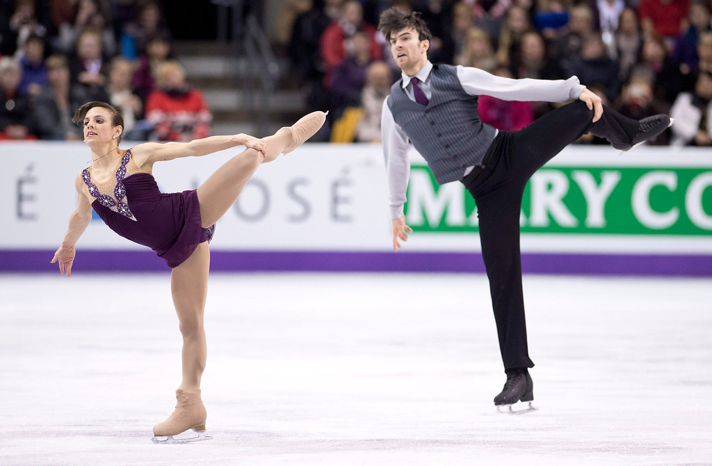. Meagan Duhamel and Eric Radford, of Canada, perform their free skate program in the pairs competition at the World Figure Skating Championships Friday, March 15, 2013 in London, Ontario. (AP Photo/The Canadian Press, Paul Chiasson)