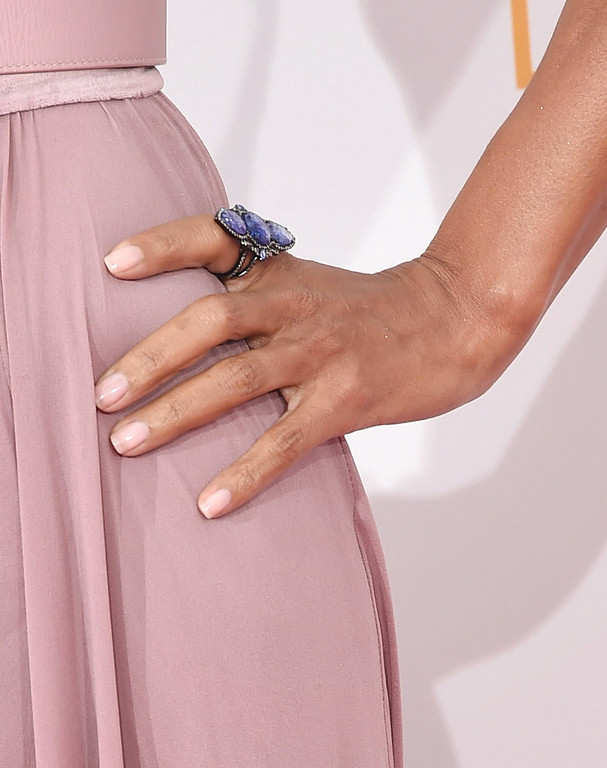 . Actress Halle Berry (jewlery detail)  poses in the press room during the 66th Annual Primetime Emmy Awards held at Nokia Theatre L.A. Live on August 25, 2014 in Los Angeles, California.  (Photo by Jason Merritt/Getty Images)