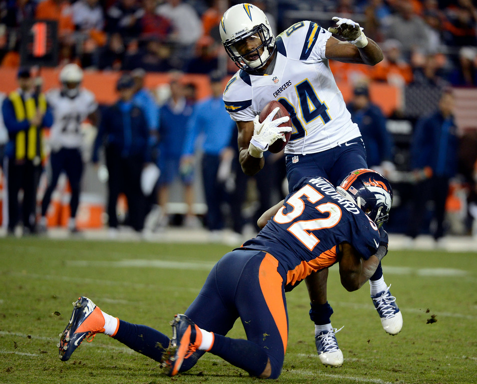 . Former Broncos outside linebacker Wesley Woodyard takes down Danario Alexander, then of the Chargers. (John Leyba, The Denver Post)