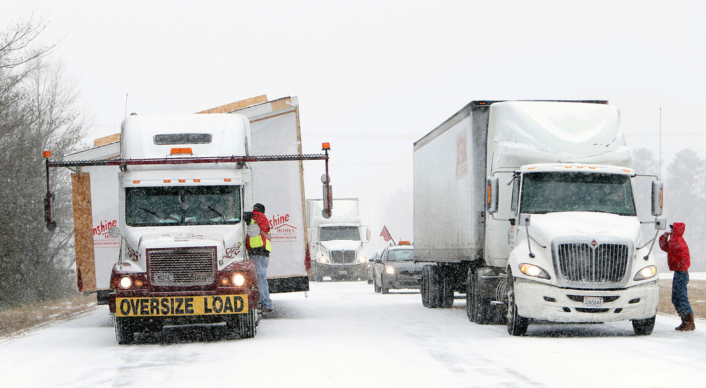 . Truckers are informed that US highway 280 has been shut down in Childersburg, Ala. Tuesday Jan. 28, 2014.  (AP Photo/Hal Yeager)