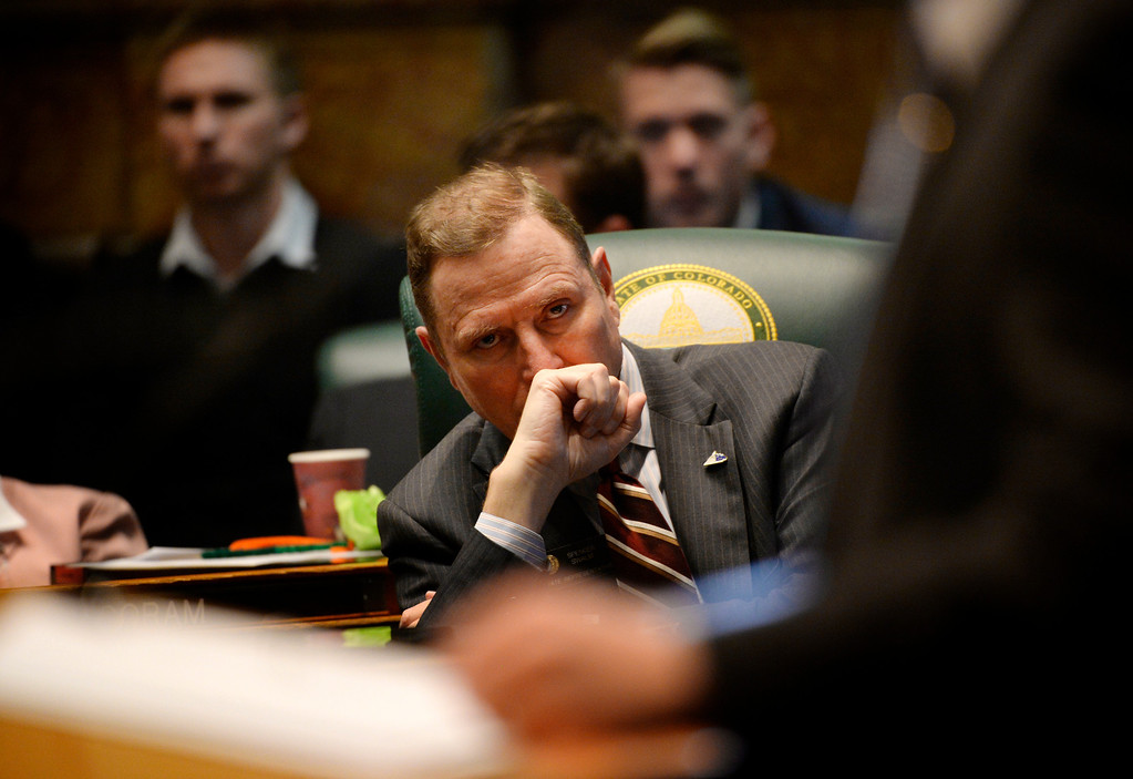 . DENVER, CO. - JANUARY 08:  Representative Spencer Swalm listens to House Minority Leader Brian DelGrosso during the first day of the new legislative session at the Colorado Capitol in Denver, CO January 08, 2014. (Photo By Craig F. Walker / The Denver Post)