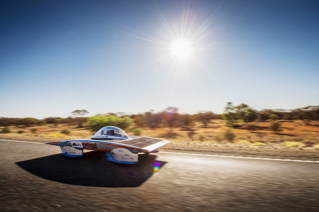 . In this photo taken on Tuesday, Oct. 8, 2013, The Indupol One of the Belgian solar team rides across a desert, 285 kilometers South of Alice Springs, Australia. The solar challenge race, lasting for seven days, will take 43 participants over 3,021 kilometers before ending on Sunday, Oct 13. (AP Photo/Geert Vanden Wijngaert)