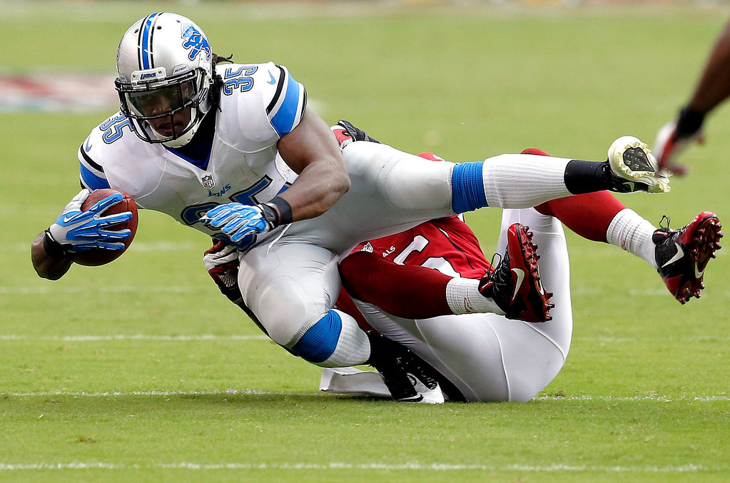 . Detroit Lions running back Joique Bell (35) is tackled by Arizona Cardinals free safety Rashad Johnson during the first half of a NFL football game, Sunday, Sept. 15, 2013, in Glendale, Ariz. (AP Photo/Ross D. Franklin)