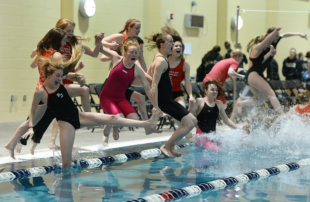. THORNTON, CO. - FEBRUARY 15, 2014: The Regis Jesuit High School girl\'s swim team jumped in to the pool to celebrate the team title Saturday. The CHSAA 5A Girl\'s State Swimming Championships wrapped up Saturday night February 14, 2104.  Photo By Karl Gehring/The Denver Post