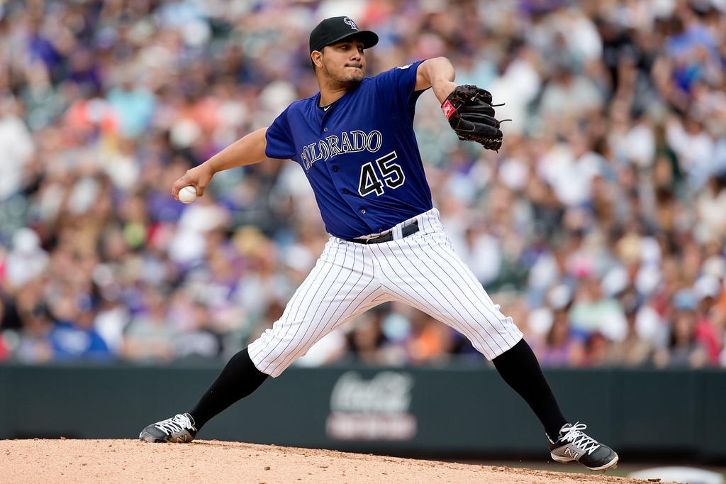 . DENVER, CO - JUNE 7:  Starting pitcher Jhoulys Chacin #45 of the Colorado Rockies delivers to home plate during the sixth inning against the Los Angeles Dodgers at Coors Field on June 7, 2014 in Denver, Colorado. The Rockies defeated the Dodgers 5-4 in 10 innings to end their eight game losing streak. (Photo by Justin Edmonds/Getty Images)