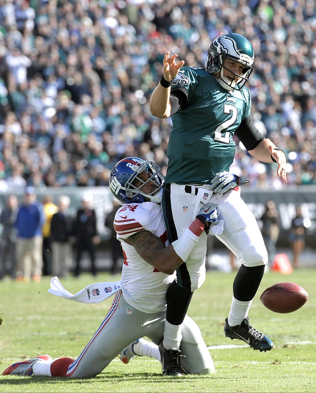 . Philadelphia Eagles quarterback Matt Barkley (2) fumbles the ball as he is hit by New York Giants\' Terrell Thomas (24) during the first half of an NFL football game Sunday, Oct. 27, 2013 in Philadelphia. (AP Photo/Michael Perez)