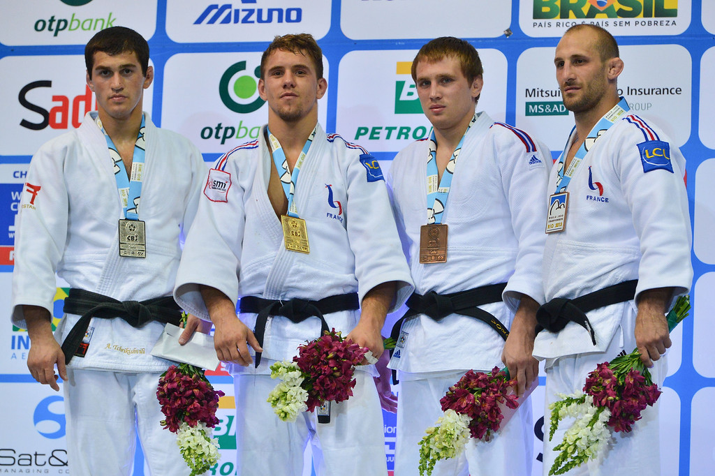 . France\'s gold medallist Loic Pietri (2-L), Georgia\'s silver medallist Avtandili Tchrikishvili (L) and bronze medallists French Alain Schmitt (R) and Russian Ivan Nifontov pose on the podium during the medal ceremony for the men\'s -81kg category, during the IJF World Judo Championship, in Rio de Janeiro, Brazil, on August 29, 2013. YASUYOSHI CHIBA/AFP/Getty Images