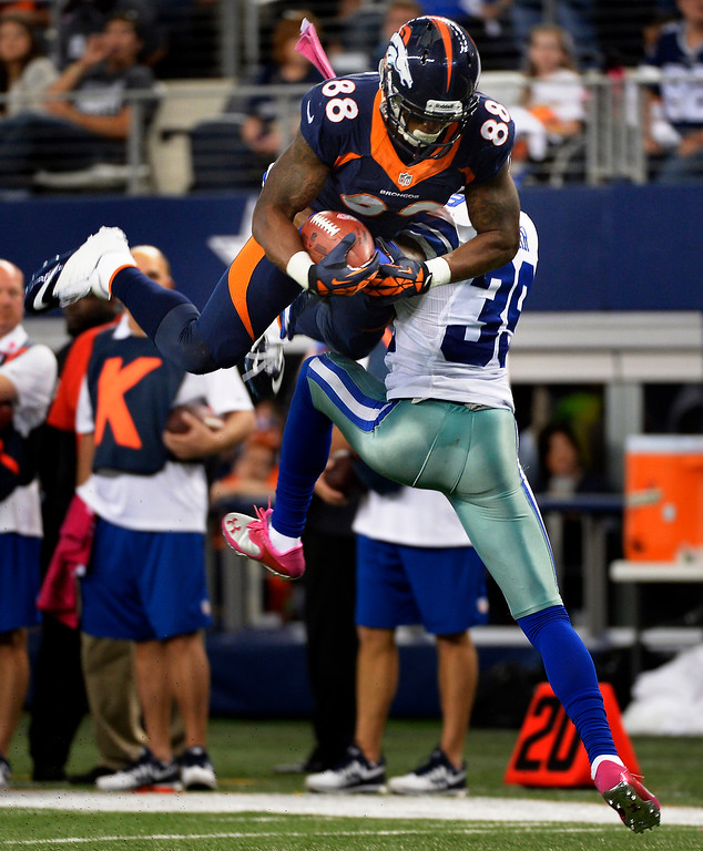 . Wide receiver Demaryius Thomas #88 of the Denver Broncos makes a long catch for a first down in a fourth quarter scoring drive against the Dallas Cowboys in game 5 at AT&T Stadium October 06, 2013 Arlington, Texas. (Photo By Joe Amon/The Denver Post)