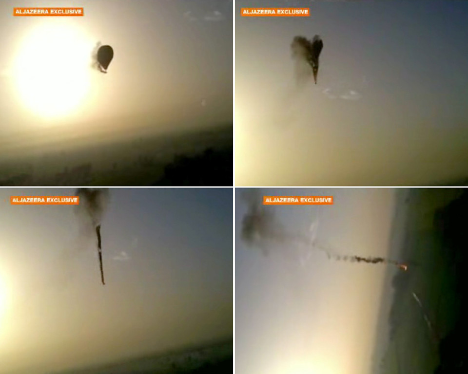 . In this combo made from images from amateur video provided by Al-Jazeera, smoke pours from a hot air balloon over Luxor, Egypt, top left, before bursting, top right, and plummeting about 1,000 feet to earth, bottom left and right, on Tuesday, Feb. 26, 2013. Nineteen people were killed in what appeared to be the deadliest hot air ballooning accident on record. A British tourist and the Egyptian pilot, who was badly burned, were the sole survivors. (AP Photo/Al-Jazeera)
