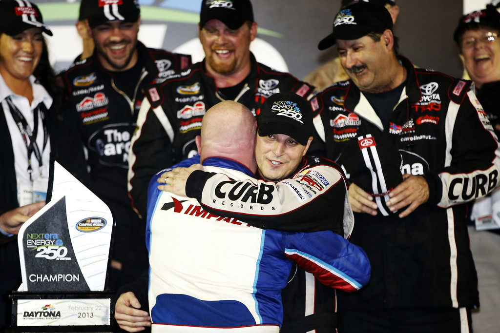 . DAYTONA BEACH, FL - FEBRUARY 22: Johnny Sauter, driver of the #98 Carolina Nut Co./Curb Records Toyota, celebrates with Todd Bodine, driver of the #13 Thorsport Racing Toyota, after winning the NASCAR Camping World Truck Series NextEra Energy Resources 250 at Daytona International Speedway on February 22, 2013 in Daytona Beach, Florida.  (Photo by Chris Graythen/Getty Images)