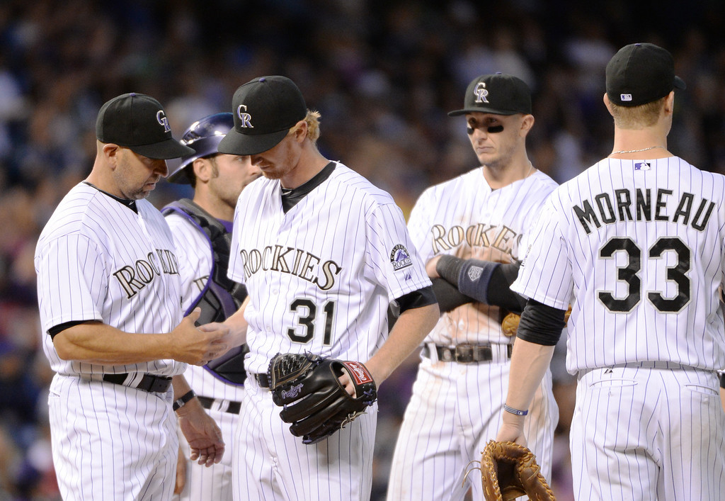 . DENVER JUNE 06: Eddie Butler of Colorado Rockies (31) hands the ball to manager Walt Weiss (22) after pitching 5 1/3 innings against Los Angeles Dodgers at Coors Field in Denver, Colorado June 6, 2014. (Photo by Hyoung Chang/The Denver Post)