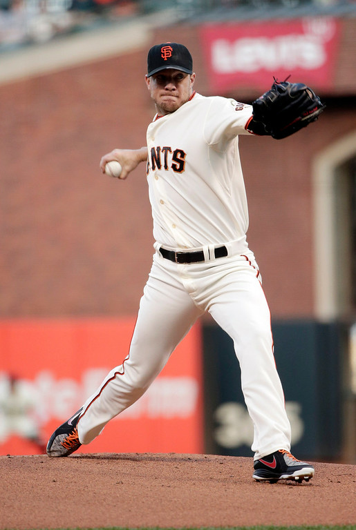 . San Francisco Giants starting pitcher Jake Peavy throws to the Colorado Rockies during the first inning of a baseball game Monday, Aug. 25, 2014, in San Francisco. (AP Photo/Marcio Jose Sanchez)