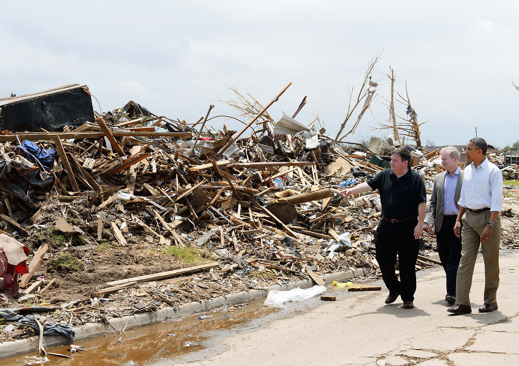 . City of Moore Mayor Glenn Lewis (L) points something out to US President Barack Obama as they visit a tornado affected area on May 26, 2013 in Moore, Oklahoma. Obama is in the Oklahoma City area to survey damage from the tornado which struck a week ago and meet with victims and first responders.    MANDEL NGAN/AFP/Getty Images