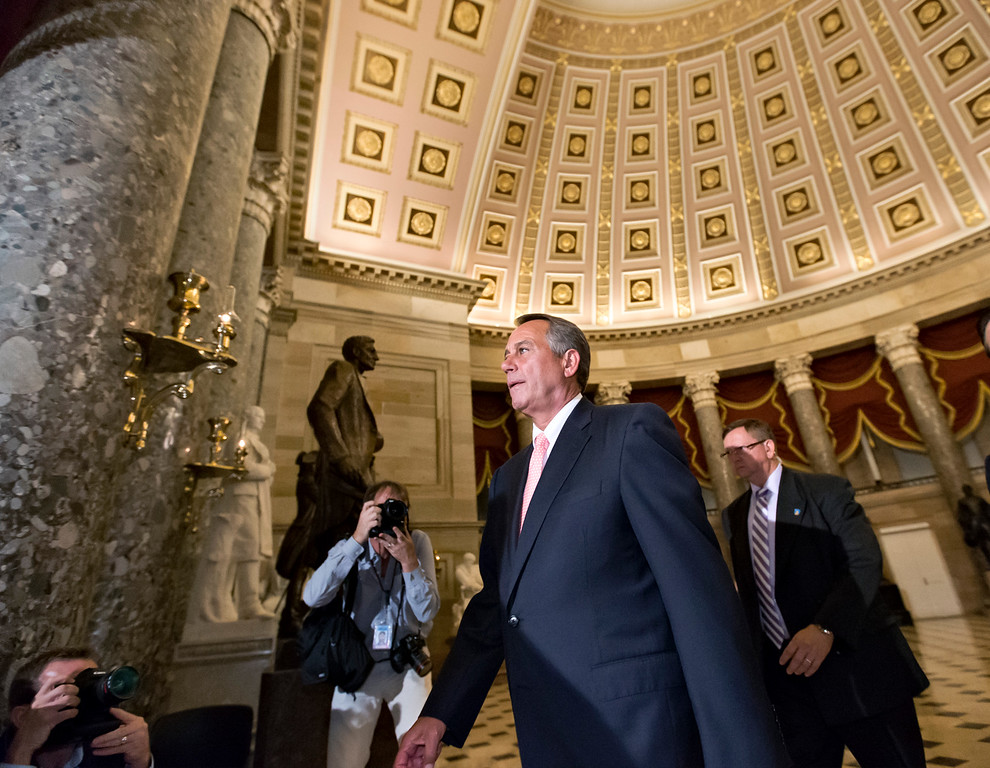 ". Speaker of the House John Boehner, R-Ohio, walks to the House floor for a vote on the continuing resolution, at the Capitol in Washington, Monday night, Sept. 30, 2013. The Republican-controlled House and the Democrat-controlled Senate are at an impasse as Congress continues to struggle over how to prevent a possible shutdown of the federal government when it runs out of money. President Barack Obama ramped up pressure on Republicans Monday to avoid a post-midnight government shutdown, saying that failure to pass a short-term spending measure to keep agencies operating would ""throw a wrench into the gears\"" of a recovering economy. (AP Photo/J. Scott Applewhite)"
