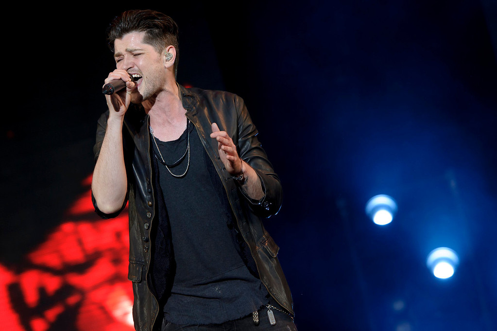 . Danny O\'Donoghue from Irish band The Script performs at the V Festival in Chelmsford, England, Saturday, Aug. 17, 2013. (Photo by Jonathan Short/Invision/AP)