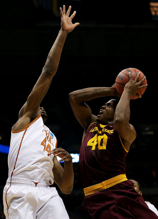 . Shaquielle McKissic #40 of the Arizona State Sun Devils shoots against Prince Ibeh #44 of the Texas Longhorns in the first half during the second round of the 2014 NCAA Men\'s Basketball Tournament at BMO Harris Bradley Center on March 20, 2014 in Milwaukee, Wisconsin.  (Photo by Jonathan Daniel/Getty Images)